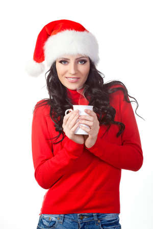woman wearing christmas hat  holding a coffee mug photo