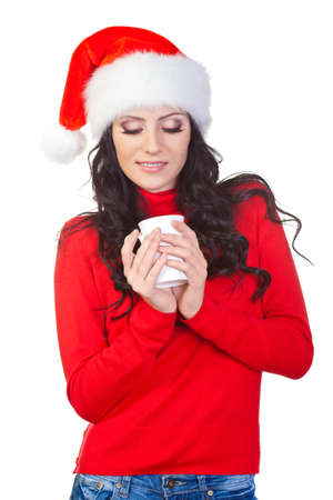 woman wearing red sweater  looking to the coffee mug photo