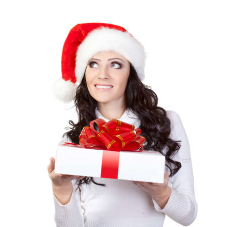 woman in santa hat dreaming over white background photo