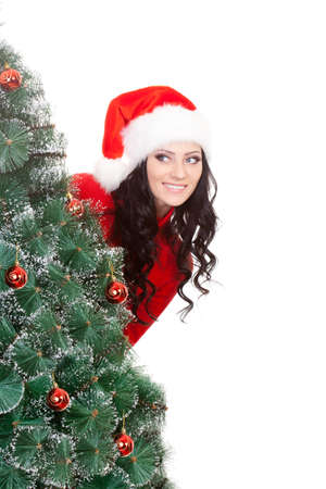 artifical: brunette woman hiding behind the artifical fur tree Stock Photo