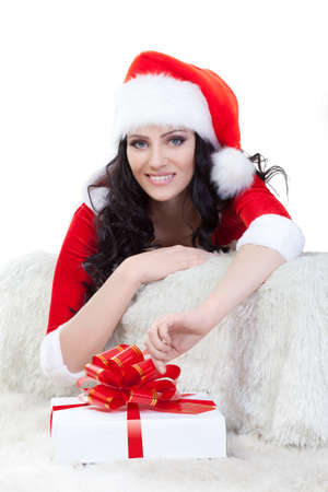 happy woman in santa costume laying on sofa over white Stock Photo - 11467262