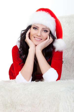 woman in santa costume laying on sofa over white photo