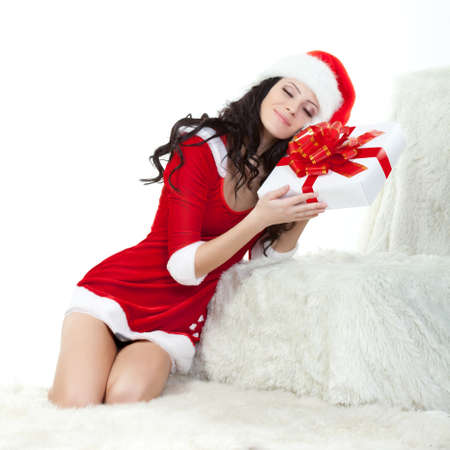 woman in santa costume holding gift box over white photo