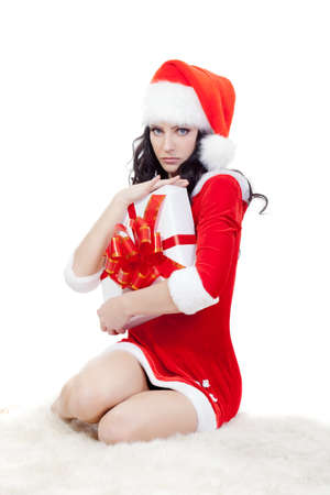 seriously woman in santa costume sitting on floor over white photo