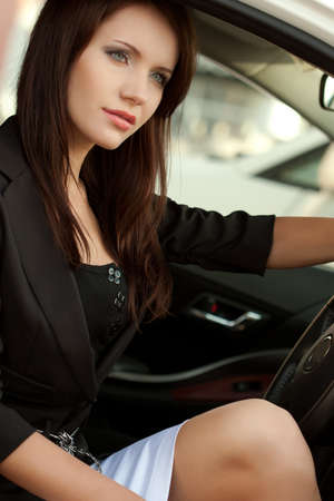 woman sitting in the car, closeup photo photo