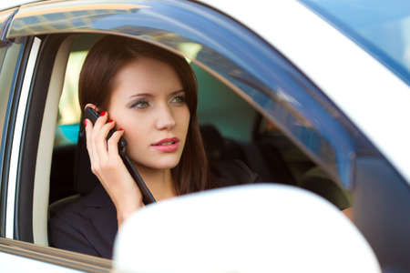 woman in car calling by cell phone photo