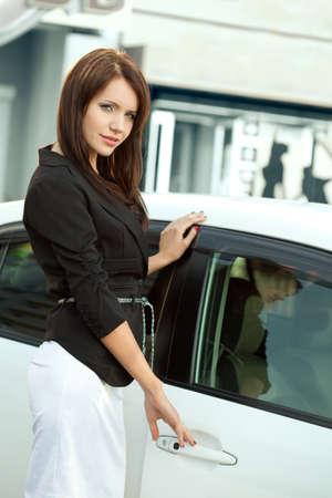woman handle success: woman holding handle of  car door