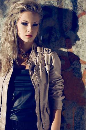 beautiful blond woman wearing leather jacket. Fashion photo