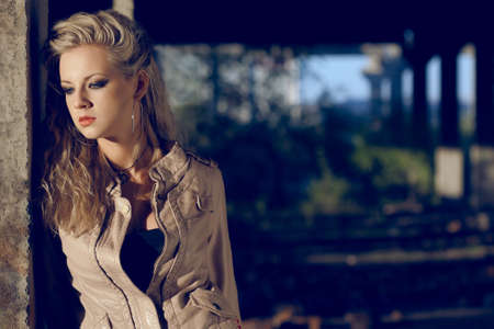 portrait blond woman wearing leather beige jacket inside ruins. Fashion photo Stock Photo - 11871851