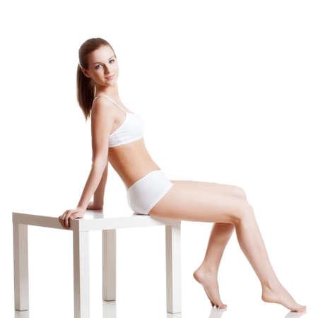 woman panties: beautiful blonde woman wearing  underwear over white background