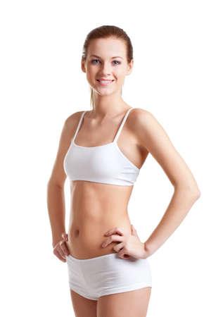 femme en sous vetements: femme blonde portant sous-vêtements blancs se tenant la main sur tour de taille Banque d'images