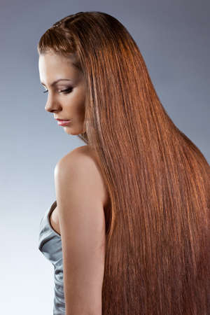 woman with long hair looking down. Studio photo Stock Photo - 11871923