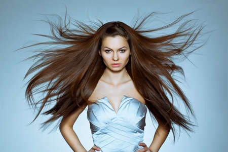 woman long hair: studio portrait of woman with flying hair