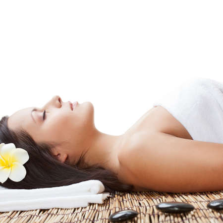 woman laying on bamboo mat in spa salon, closeup view photo