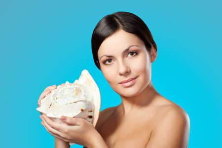 beautiful happy woman holding seashell photo