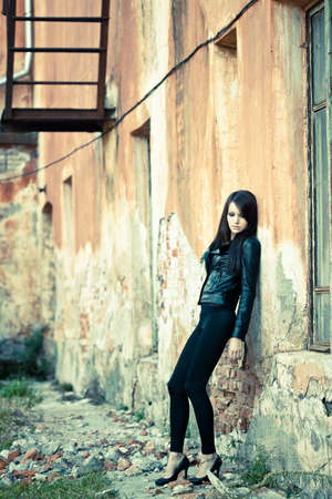 brunette woman wearing leather jacket photo