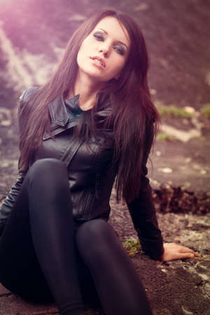 woman portrait wearing leather jacket with lens flare effect photo