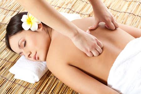 back massage: woman receiving back massage at spa salon Stock Photo