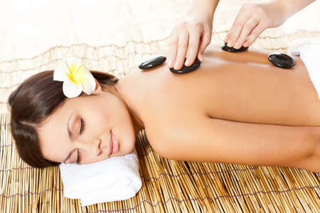 day spa: woman receiving back massage at spa salon Stock Photo