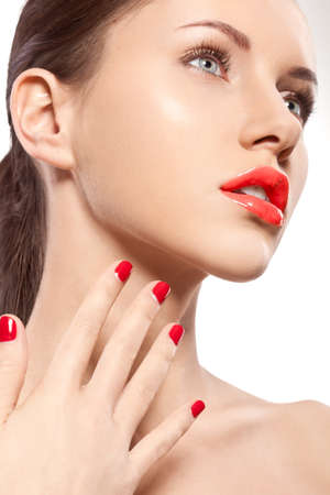 closeup woman portrait with red nails and lips photo