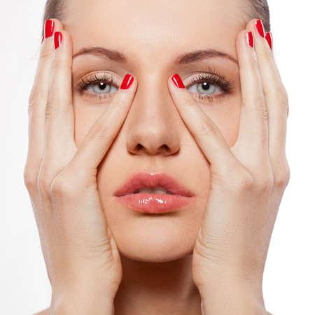 closeup woman portrait with hands on faec