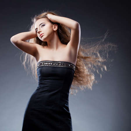 woman with long flying  hair holding hands on head Stock Photo - 13004584