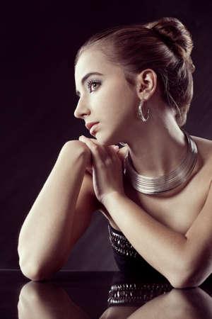 closeup portrait  of brunette woman wearing silver jewellry