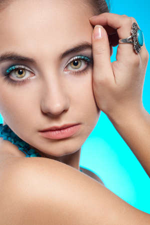 closeup brunette woman face portrait with turquoise necklace and ring on finger Stock Photo - 13005019