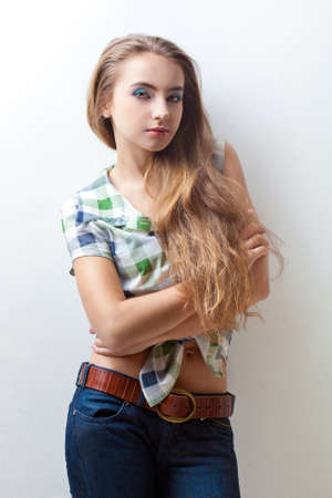 young wwoman wearing jeans and plaid shirt Stock Photo - 13004635