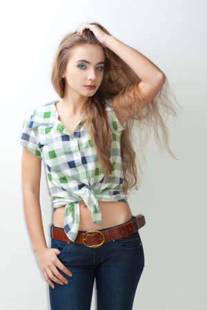 young woman wearing jeans and woman wearing jeans and plaid shirt holding hand on head Stock Photo - 13004619