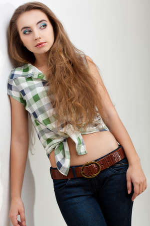 fashion model young woman wearing country style clothes, studio portrait Stock Photo - 13004914