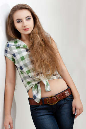 young woman wearing country style clothes, studio portrait looking at camera Stock Photo - 13004687