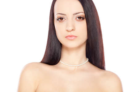 beauty woman portrait over white with pearl necklace  photo