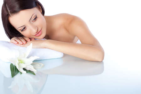 beautiful brunette woman holding head on hands  Spa theme