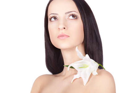brunette woman portrait with clear skin  Lily on shoulder Stock Photo - 13271842