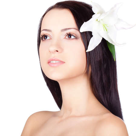brunette woman portrait with clear skin  Lily on on head Stock Photo - 13271836