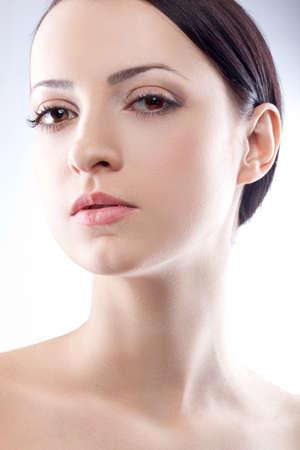 closeup brunette woman studio portrait over white blue Фото со стока
