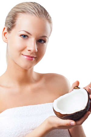 beautiful woman with perfect skin holding coconut, spa and cosmetics theme photo