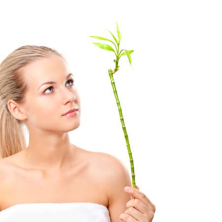 blonde girl holding the bamboo over white background photo