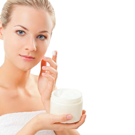 closeup blond woman holding jar with cream over white background, space for the text photo