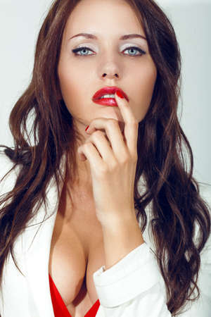 portrait of sexy woman brunette, which deals with his finger near the mouth photo
