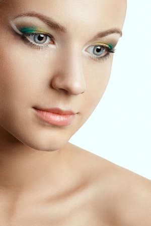 closeup beautiful woman face with creative makeup photo
