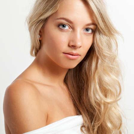 beautiful blonde woman closeup face portrait, square frame