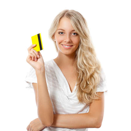 card payment: blonde happy woman holding yellow credit card Stock Photo