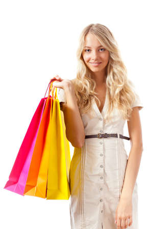 happy blonde woman holding shopping bags over white, copy space for text photo
