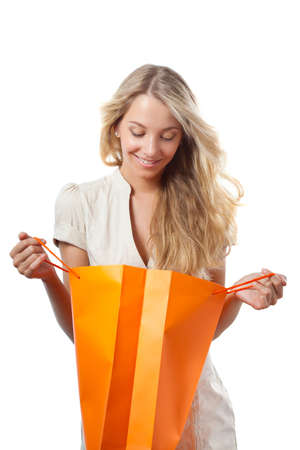 opened bag: happy blonde woman holding opened shopping bag