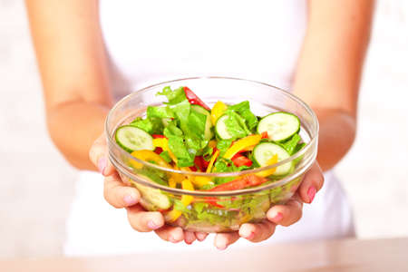 woman holding  fresh  salad in glass boil photo