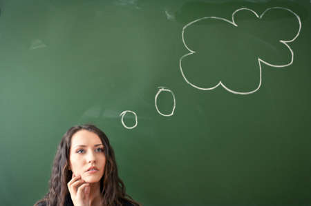woman over blackboard with funny cloud picture photo