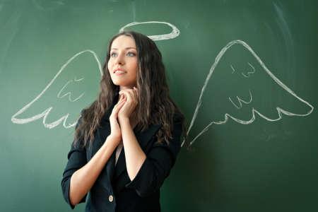 nimbus: girl over chalkboard with funny angel wings and nimbus
