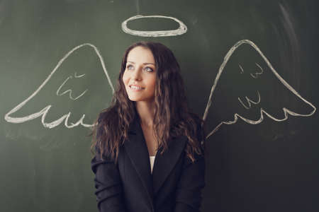 girl over chalkboard with funny angel wings and nimbus